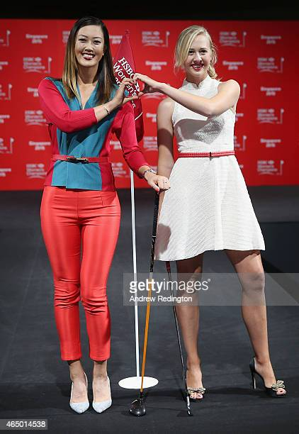 Michelle Wie and Jessica Korda of the United States pose together on the catwalk during the launch event at the Fairmont Hotel prior to the start of...