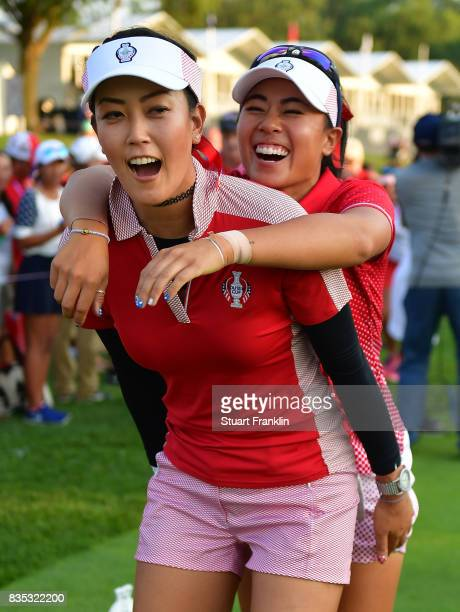 Michelle Wie gives a piggy back to Danielle Kang of Team USA during the afternoon fourball matches of The Solheim Cup at Des Moines Golf and Country...