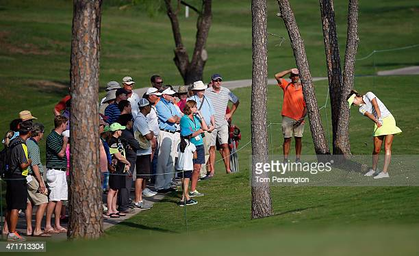 Michelle Wie hits a shot on the ninth hole during Round One of the 2015 Volunteers of America North Texas Shootout Presented by JTBC at Las Colinas...