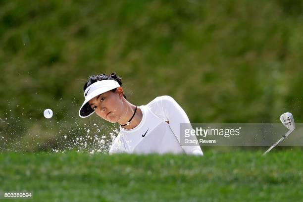 Michelle Wie hits from a green side bunker on the seventh hole during the first round of the 2017 KPMG PGA Championship at Olympia Fields Country...