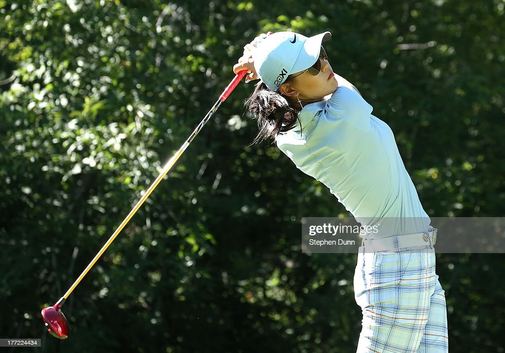 <a gi-track='captionPersonalityLinkClicked' href=/galleries/search?phrase=Michelle+Wie&family=editorial&specificpeople=201982 ng-click='$event.stopPropagation()'>Michelle Wie</a> hits her tee shot on the fifth hole during the CN Canadian Women's Open at Royal Mayfair Golf Club on August 22, 2013 in Edmonton, Alberta, Canada.