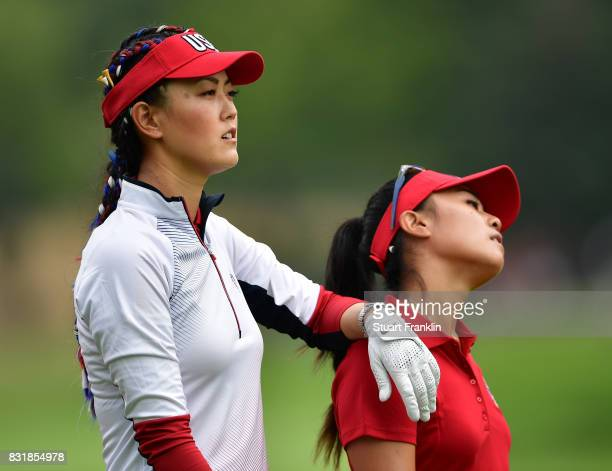 Michelle Wie leans ob Danielle Kang of Team USA during practice for The Solheim Cup at the Des Moines Country Club on August 15 2017 in West Des...