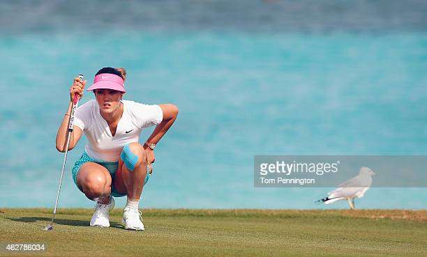 Michelle Wie lines up a putt on the eighth green during round one of the Pure Silk Bahamas LPGA Classic at the Ocean Club course on February 5 2015...