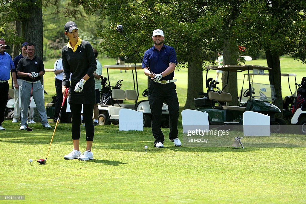 <a gi-track='captionPersonalityLinkClicked' href=/galleries/search?phrase=Michelle+Wie&family=editorial&specificpeople=201982 ng-click='$event.stopPropagation()'>Michelle Wie</a>, LPGA Professional, and Bobby Bradley, World Long Driver Finalist, attend the Ron Jaworski's Celebrity Golf Challenge May 20, 2013 at Atlantic City Country Club in Northfield, New Jersey.