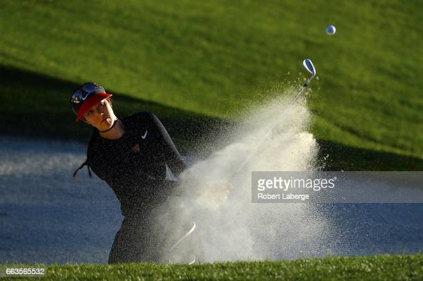 Michelle Wie makes a shot out of a bunker on the 17th hole during the third round of the ANA Inspiration on the Dinah Shore Tournament Course at...