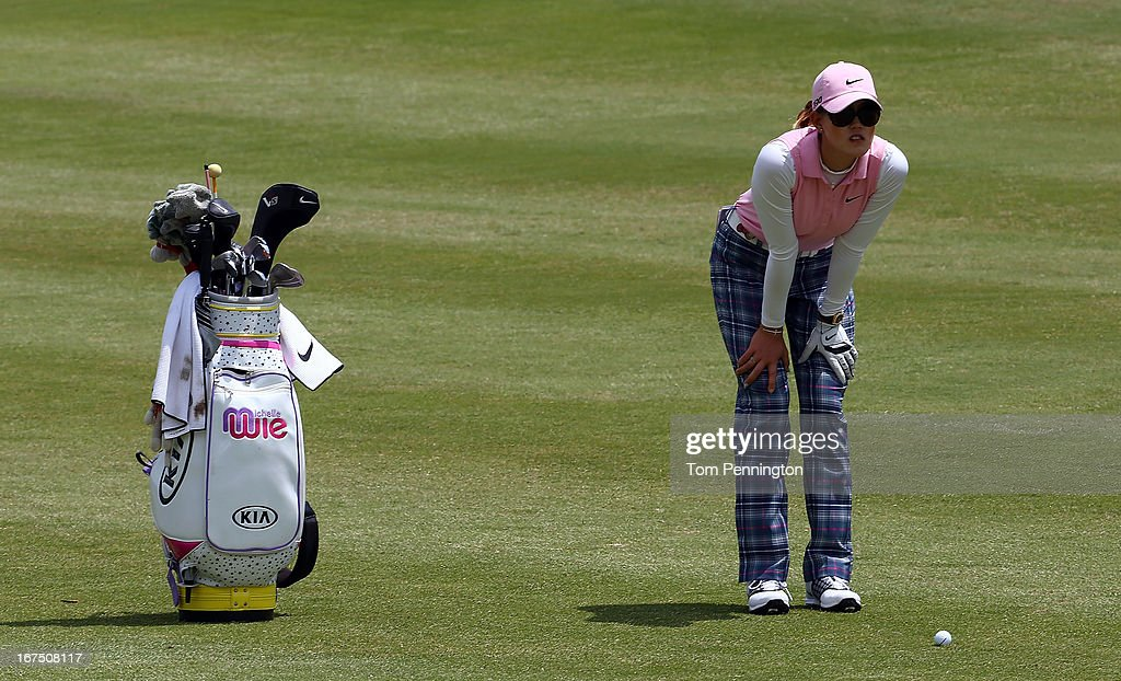 <a gi-track='captionPersonalityLinkClicked' href=/galleries/search?phrase=Michelle+Wie&family=editorial&specificpeople=201982 ng-click='$event.stopPropagation()'>Michelle Wie</a> of Honolulu, HI eyes a shot during the first round of the 2013 North Texas LGPA Shootout at the Las Colinas Country Club on April 25, 2013 in Irving, Texas.