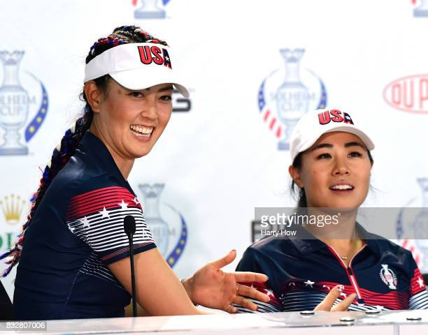 Michelle Wie of Team USA motions toward Danielle Kang as they field questions during press conference for the Solheim Cup at the Des Moines Golf and...