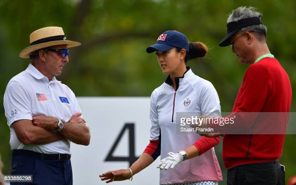 Michelle Wie of Team USA talks with her coach David Leadbetter during practice prior to The Solheim Cup at Des Moines Golf and Country Club on August...