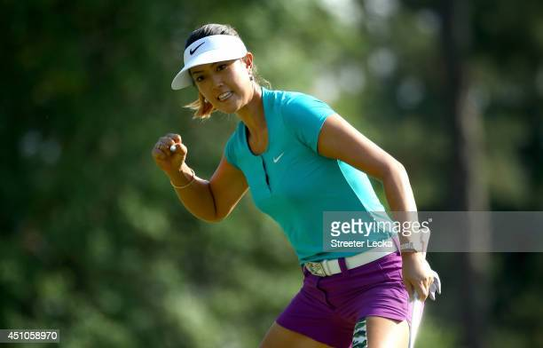 Michelle Wie of the United States celebrates a birdie putt on the 17th hole during the final round of the 69th US Women's Open at Pinehurst Resort...