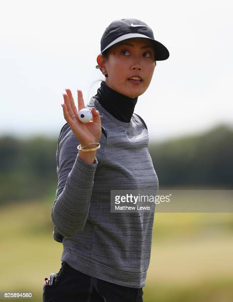 Michelle Wie of the United States celebrates her putt on the 18th green during the first round of the Ricoh Women's British Open at Kingsbarns Golf...