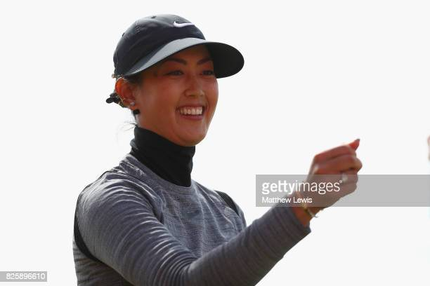 michelle wie of the united states celebrates her putt on the 18th green during the first