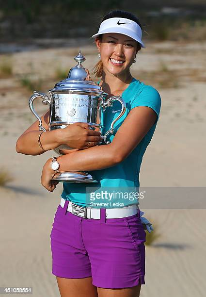 Michelle Wie of the United States celebrates with the trophy after winning in the final round of the 69th US Women's Open at Pinehurst Resort Country...