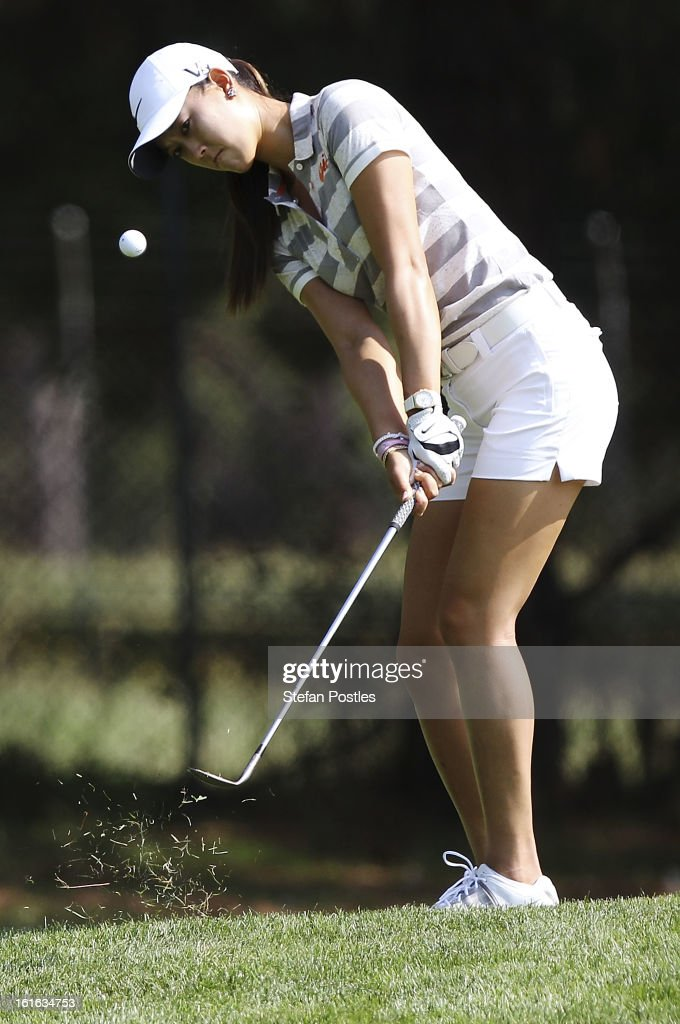 Michelle Wie of the United States chips onto the green on the 14th hole during day one of the ISPS Handa Australian Open at Royal Canberra Golf Club on February 14, 2013 in Canberra, Australia.