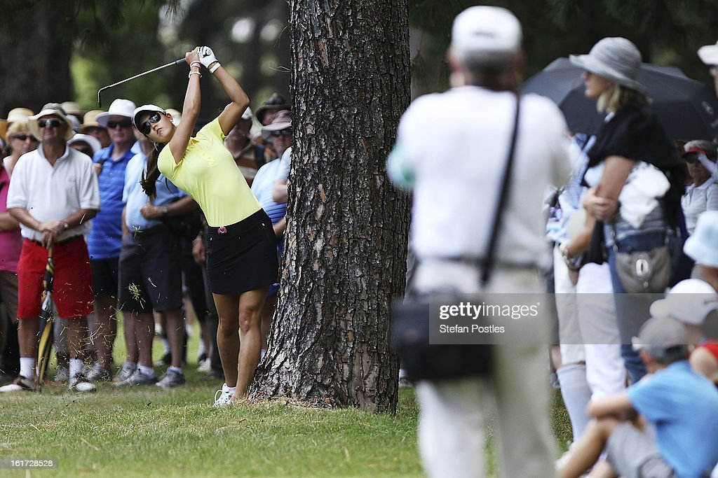 Michelle Wie of the United States hits out of the rough during day two of the ISPS Handa Australian Open at Royal Canberra Golf Club on February 15, 2013 in Canberra, Australia.