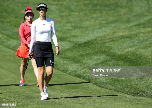 Michelle Wie of the United States leads Lucy Li of the United States the 14yr old amateur qualifier off the tee after their tee shots on the par 3...