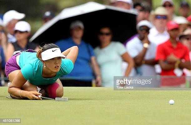 Michelle Wie of the United States lines up a putt on the seventh hole during the final round of the 69th US Women's Open at Pinehurst Resort Country...