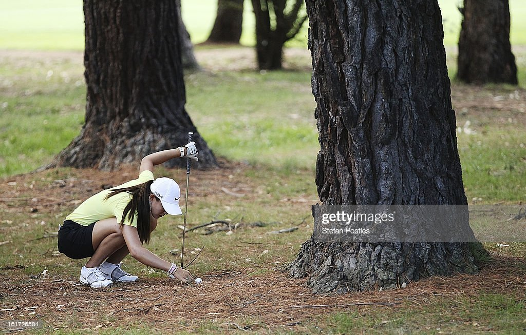 Michelle Wie of the United States moves sticks around her ball in the rough on the 15th hole during day two of the ISPS Handa Australian Open at Royal Canberra Golf Club on February 15, 2013 in Canberra, Australia.