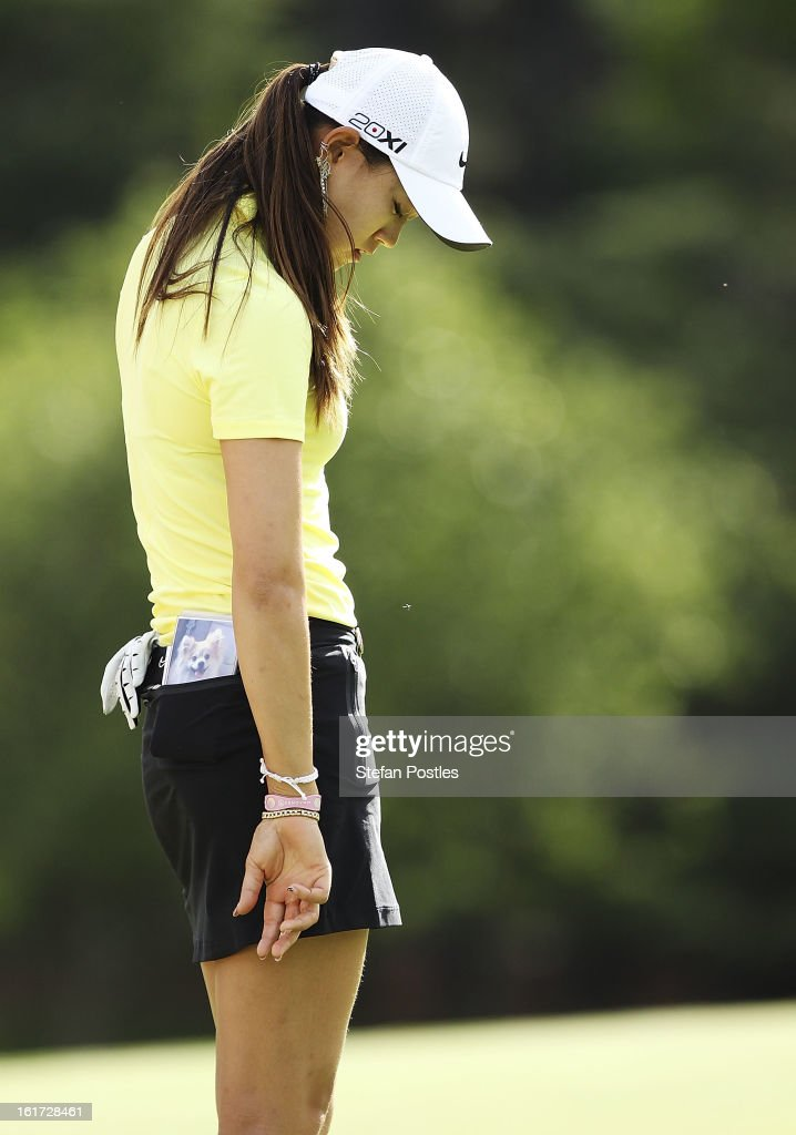 Michelle Wie of the United States reacts after missing a putt during day two of the ISPS Handa Australian Open at Royal Canberra Golf Club on February 15, 2013 in Canberra, Australia.