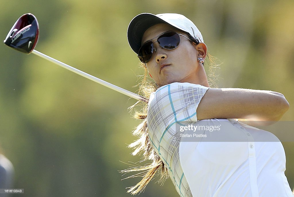 <a gi-track='captionPersonalityLinkClicked' href=/galleries/search?phrase=Michelle+Wie&family=editorial&specificpeople=201982 ng-click='$event.stopPropagation()'>Michelle Wie</a> of the United States tee's off during practice ahead of the ISPS Handa Australian Open at Royal Canberra Golf Club on February 13, 2013 in Canberra, Australia.