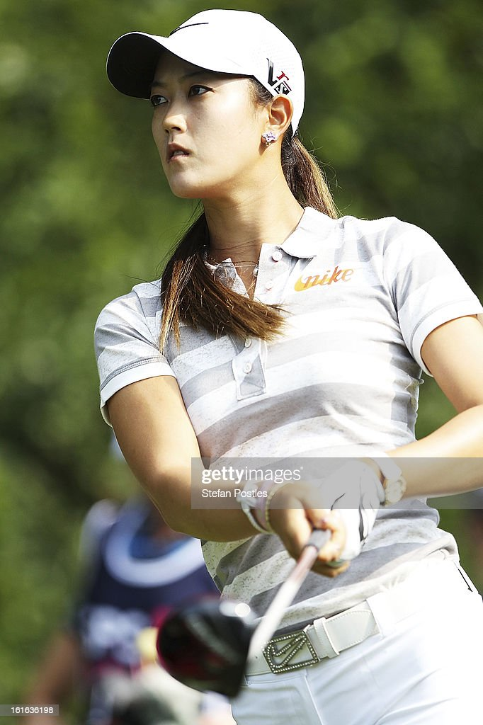 Michelle Wie of the United States watches her ball during day one of the ISPS Handa Australian Open at Royal Canberra Golf Club on February 14, 2013 in Canberra, Australia.