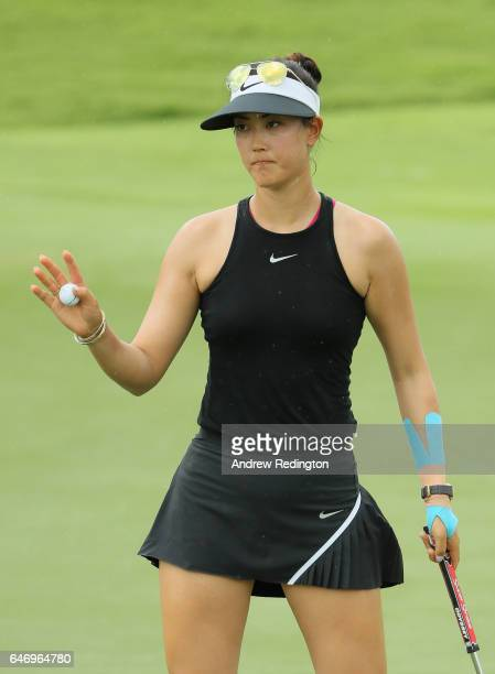 Michelle Wie of the United States waves to the crowd on the 18th hole during the first round of the HSBC Women's Champions on the Tanjong Course at...