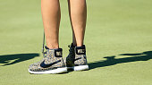 Michelle Wie of the United States wearing 'hitop' golf shoes during the third round of the 2016 ANA Inspiration at the Mission Hills Country Club on...