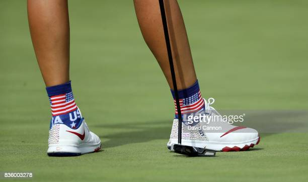 Michelle Wie of the United States wearing patriotic shoes in her match against Caroline Masson of the European team during the final day singles...