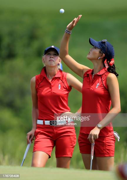 Michelle Wie of the USA catches her ball on the first hole as her partner Jessica Korda looks on during the afternoon fourball matches for the 2013...