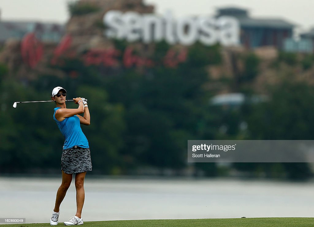 <a gi-track='captionPersonalityLinkClicked' href=/galleries/search?phrase=Michelle+Wie&family=editorial&specificpeople=201982 ng-click='$event.stopPropagation()'>Michelle Wie</a> of the USA hits a shot on the 15th hole during the second round of the HSBC Women's Champions at the Sentosa Golf Club on March 1, 2013 in Singapore, Singapore.
