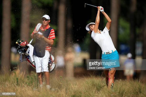 Michelle Wie of the USA plays her second shot at the par 4 13th hole during the first round of the 69th US Women's Open at Pinehurst Resort Country...