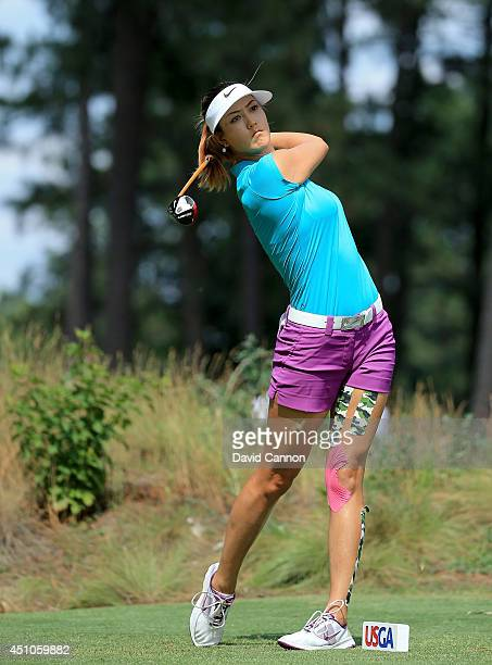 Michelle Wie of the USA plays her tee shot at the par 4 11th hole during the final round of the 69th US Women's Open at Pinehurst Resort Country Club...