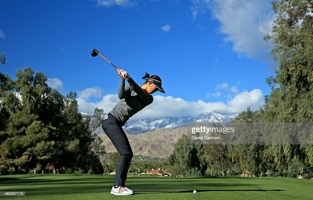 <a gi-track='captionPersonalityLinkClicked' href=/galleries/search?phrase=Michelle+Wie&family=editorial&specificpeople=201982 ng-click='$event.stopPropagation()'>Michelle Wie</a> of the USA plays her tee shot on the par 4, third hole during the pro-am as a preview for the 2014 Kraft Nabisco Championship on the Dinah Shore Tournament Course at Mission Hills Country Club on April 2, 2014 in Rancho Mirage, California.
