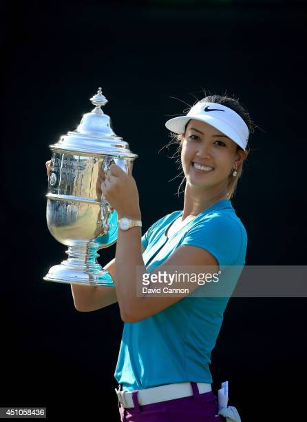Michelle Wie of the USA proudly holds the trophy after her victory during the final round of the 69th US Women's Open at Pinehurst Resort Country...