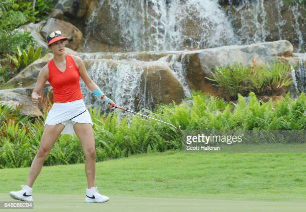 Michelle Wie of the USA reacts to a birdie putt on the third hole during the final round of the HSBC Women's Champions on the Tanjong Course at...