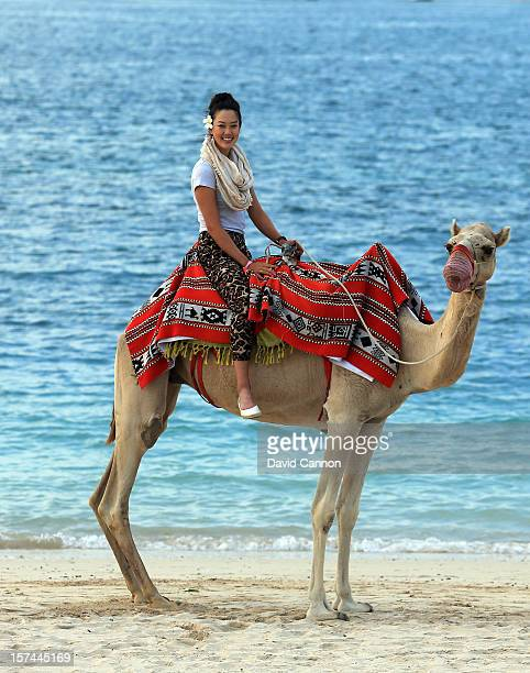 Michelle Wie of the USA riding a camel on the beach at the Jebel Ali Golf Resort and Spa as a preview for the 2012 Omega Dubai Ladies Masters on...