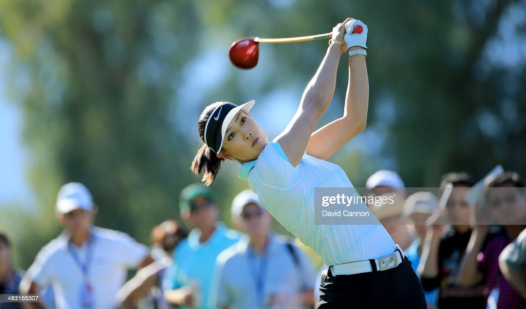<a gi-track='captionPersonalityLinkClicked' href=/galleries/search?phrase=Michelle+Wie&family=editorial&specificpeople=201982 ng-click='$event.stopPropagation()'>Michelle Wie</a> of the USA tees off on the par 4, 13th hole during the final round of the 2014 Kraft Nabisco Championship on the Dinah Shore Tournament Course at Mission Hills Country Club on April 6, 2014 in Rancho Mirage, California.