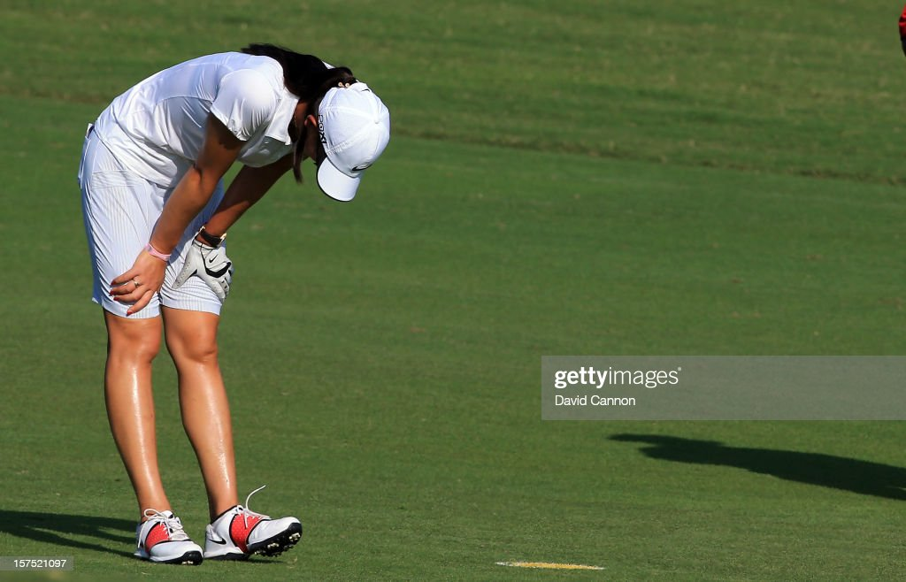 <a gi-track='captionPersonalityLinkClicked' href=/galleries/search?phrase=Michelle+Wie&family=editorial&specificpeople=201982 ng-click='$event.stopPropagation()'>Michelle Wie</a> of the USA who has been feeling unwell bends over before she played her second shot at the par 4, 9th hole during the pro-am as a preview for the 2012 Omega Dubai Ladies Masters on the Majilis Course at the Emirates Golf Club on December 4, 2012 in Dubai, United Arab Emirates.