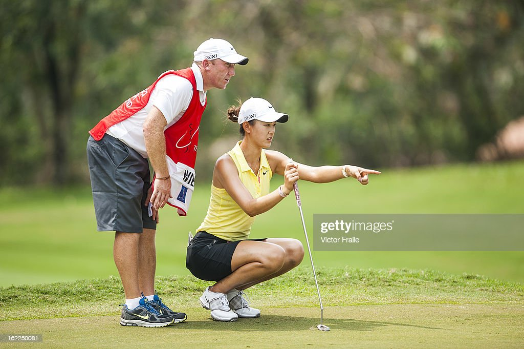 <a gi-track='captionPersonalityLinkClicked' href=/galleries/search?phrase=Michelle+Wie&family=editorial&specificpeople=201982 ng-click='$event.stopPropagation()'>Michelle Wie</a> of USA lines up a putt on the 7th green during day one of the 2013 Honda LPGA Thailand at Siam Country Club on February 21, 2013 in Chon Buri, Thailand.