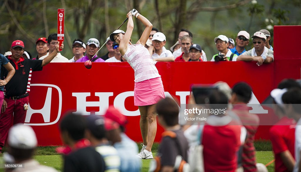 <a gi-track='captionPersonalityLinkClicked' href=/galleries/search?phrase=Michelle+Wie&family=editorial&specificpeople=201982 ng-click='$event.stopPropagation()'>Michelle Wie</a> of USA tees off on the 18th hole during day four of the Honda LPGA Thailand at Siam Country Club on February 24, 2013 in Chon Buri, Thailand.