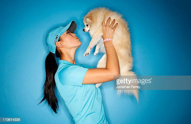 Michelle Wie poses for a portrait with her Pomeranian Lola on March 22 2011 at the Industry Hills Golf Club in the City of Industry California