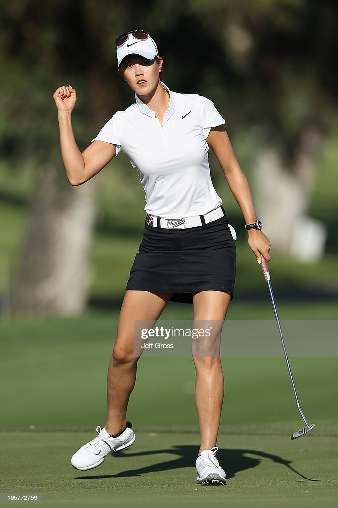 <a gi-track='captionPersonalityLinkClicked' href=/galleries/search?phrase=Michelle+Wie&family=editorial&specificpeople=201982 ng-click='$event.stopPropagation()'>Michelle Wie</a> reacts after making a birdie putt on the 15th hole during the second round of the Kraft Nabisco Championship at Mission Hills Country Club on April 5, 2013 in Rancho Mirage, California.