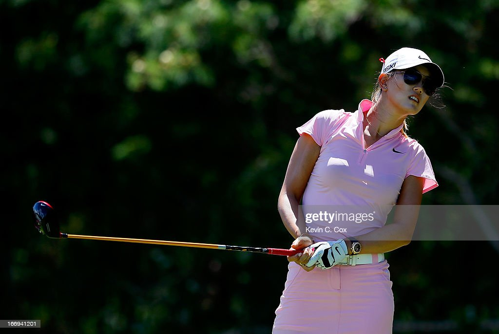 Michelle Wie reacts after teeing off the fifth hole during the second round of the LPGA LOTTE Championship Presented by J Golf at the Ko Olina Golf Club on April 18, 2013 in Kapolei, Hawaii.