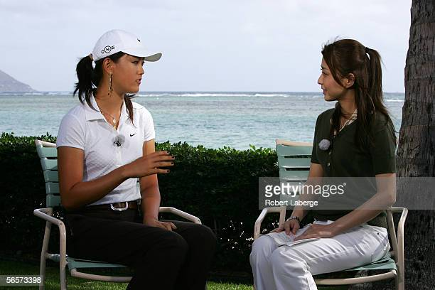 Michelle Wie speaks with show host Mao Kobayashi during an interview for Fuji Television at the Sony Open at the Waialae Country Club on January 11...