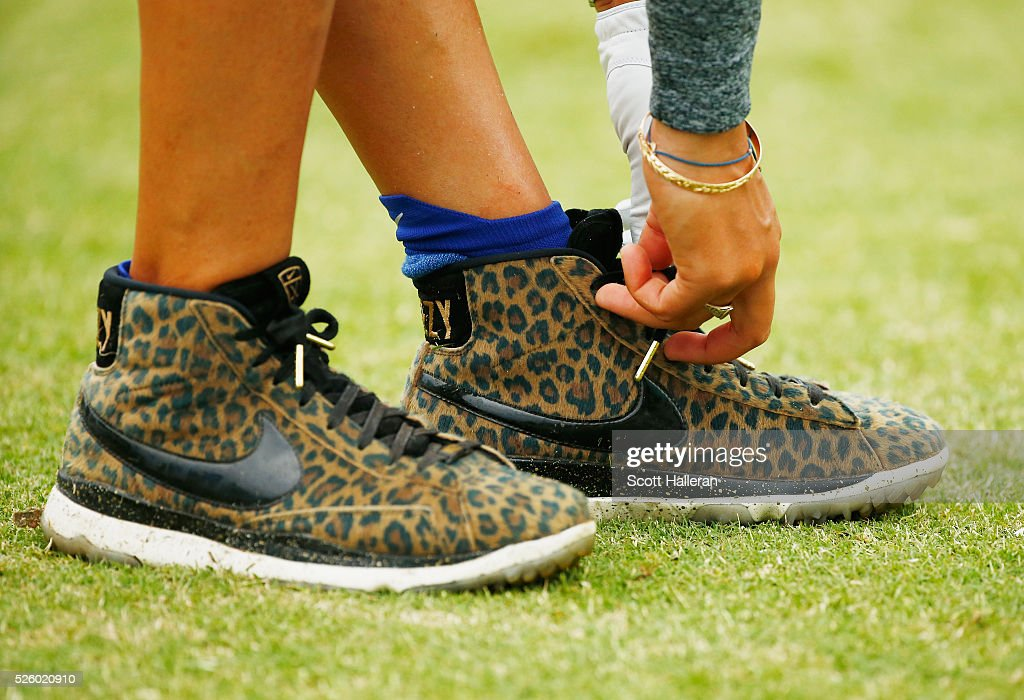 <a gi-track='captionPersonalityLinkClicked' href=/galleries/search?phrase=Michelle+Wie&family=editorial&specificpeople=201982 ng-click='$event.stopPropagation()'>Michelle Wie</a> ties her shoelaces on the first tee during the second round of the Volunteers of America Texas Shootout at Las Colinas Country Club on April 29, 2016 in Irving, Texas.