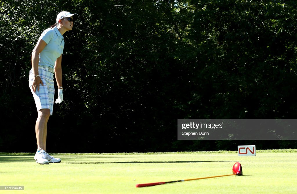 <a gi-track='captionPersonalityLinkClicked' href=/galleries/search?phrase=Michelle+Wie&family=editorial&specificpeople=201982 ng-click='$event.stopPropagation()'>Michelle Wie</a> watches her tee shot after dropping her club on the fifth hole during the CN Canadian Women's Open at Royal Mayfair Golf Club on August 22, 2013 in Edmonton, Alberta, Canada.