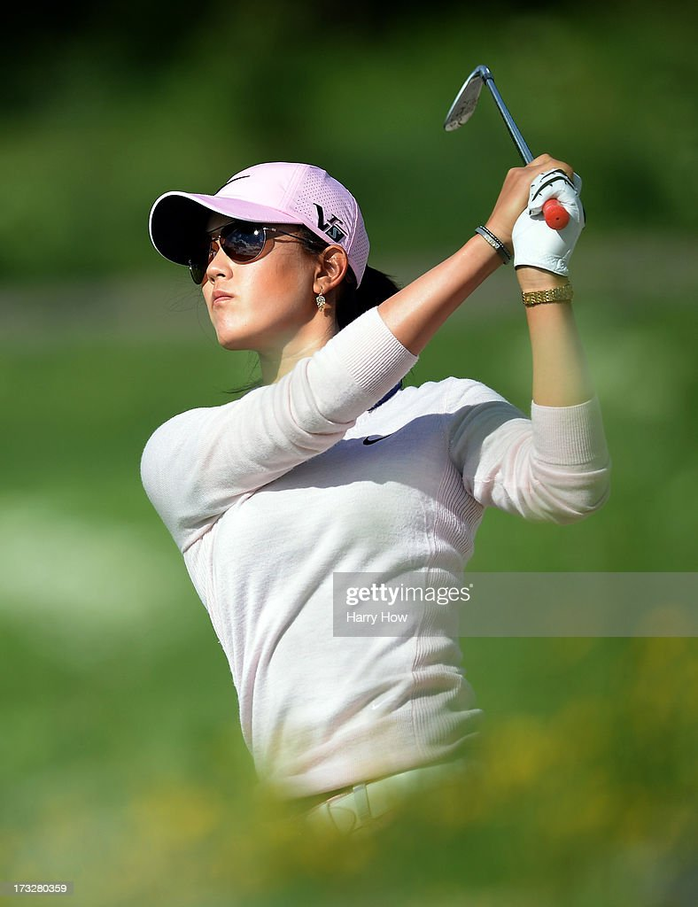 Michelle Wie watches her third shot from the rough on the third hole during round one of the Manulife Financial LPGA Classic at the Grey Silo Golf Course on July 11, 2013 in Waterloo, Canada.