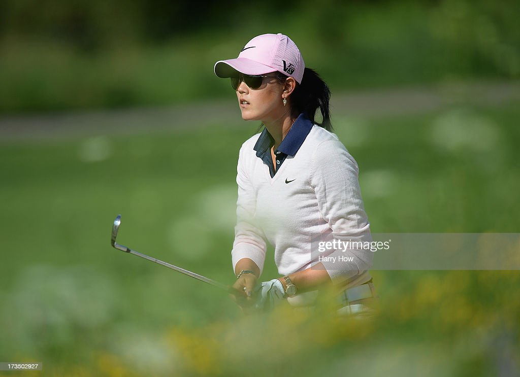 <a gi-track='captionPersonalityLinkClicked' href=/galleries/search?phrase=Michelle+Wie&family=editorial&specificpeople=201982 ng-click='$event.stopPropagation()'>Michelle Wie</a> watches her third shot from the rough on the third hole during round one of the Manulife Financial LPGA Classic at the Grey Silo Golf Course on July 11, 2013 in Waterloo, Canada.