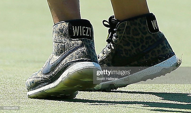 Michelle Wie's golf shoes are seen on the second green during the first round of the Volunteers of America Texas Shootout at Las Colinas Country Club on April 28, 2016 in Irving, Texas.