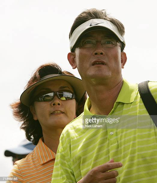 Michelle Wie's parents Bo and BJ watch a tee shot during the Quarterfinals of the HSBC Women's World Match Play Championship on July 8 2006 at...