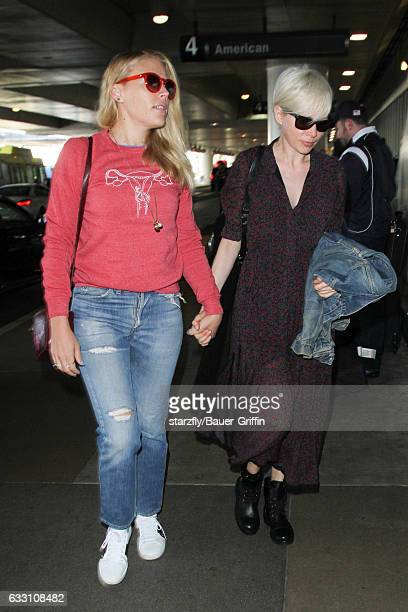 Michelle Williams and Busy Philipps are seen at LAX on January 30 2017 in Los Angeles California